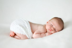 sleeping newborn baby on a blanket